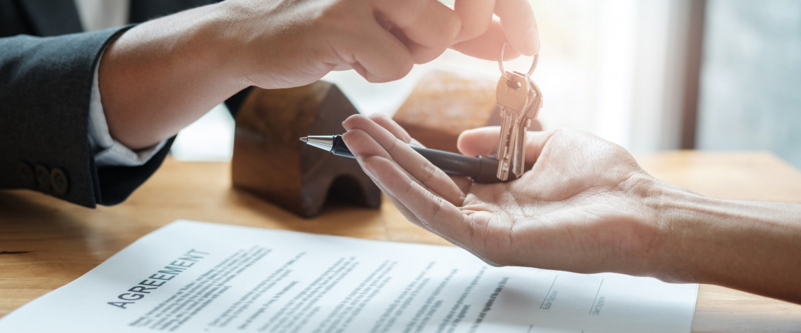 An ENB banker hands a client keys