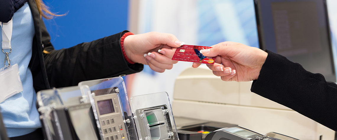 An Ephrata National Bank business customer uses her business debit card