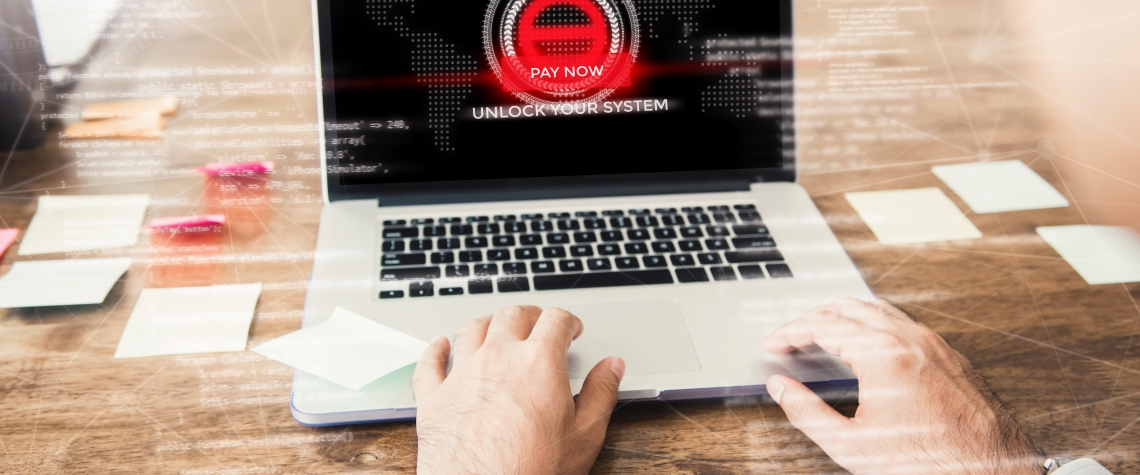 Laptop computer with the system being locked by ransomware cyber attack