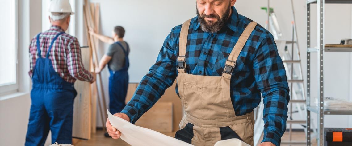 Contractor Checking a Blueprint
