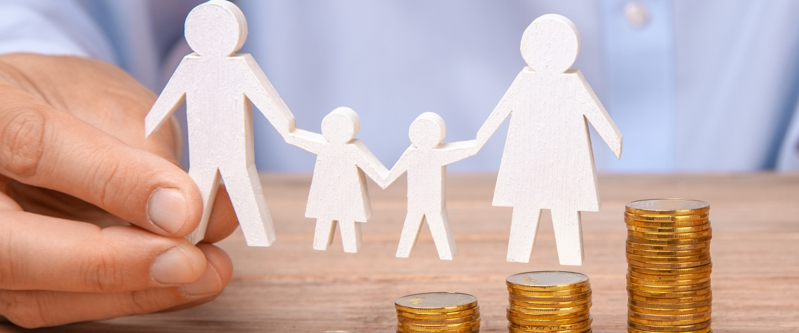 Budget of the family. Coins pile and the symbol of the family with the pope, mother, daughter and son