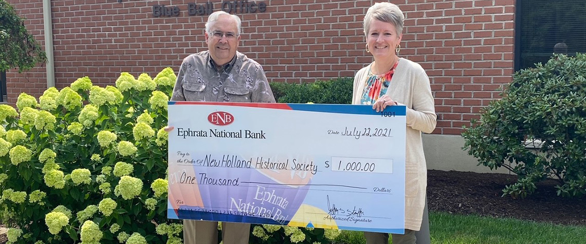 Members of the New Holland Historical Society receiving a check from ENB