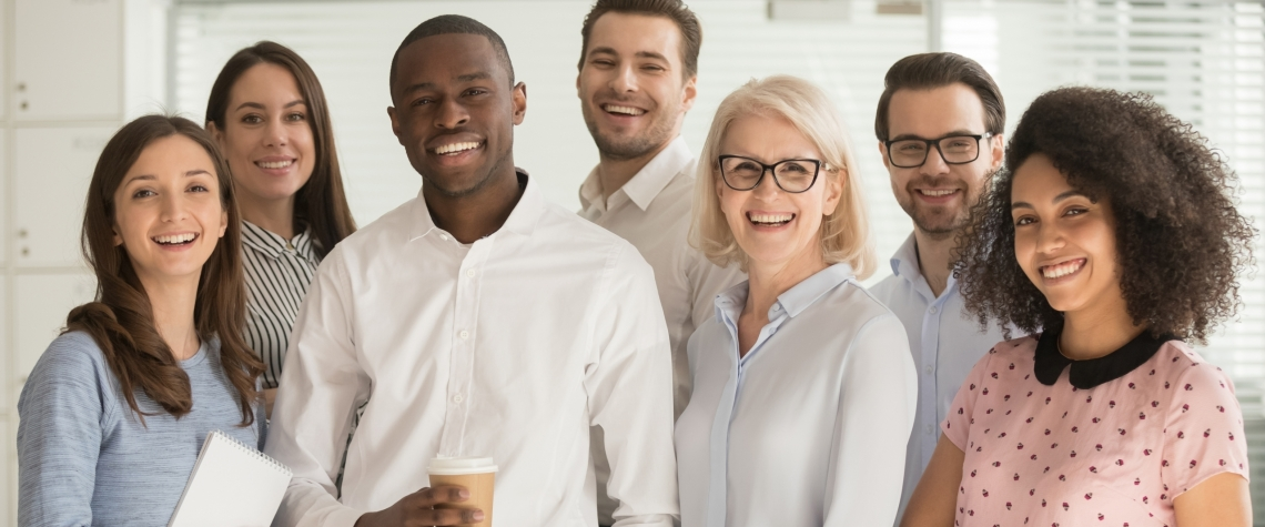 Motivated international multi-ethnic company members aged and young corporate team photographing posing for camera, successful staff portrait concept of growth in career leadership and racial equality